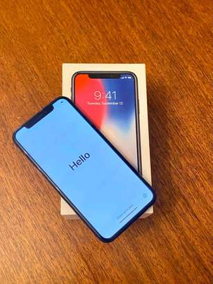 Apple IPhone x black with iwatch.  256 gb image 2