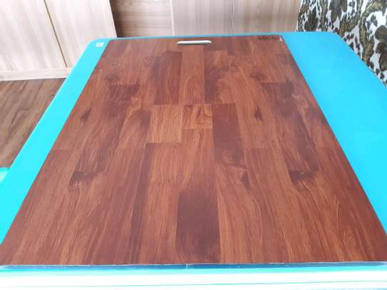 Laminated wooden floor tiles image 5