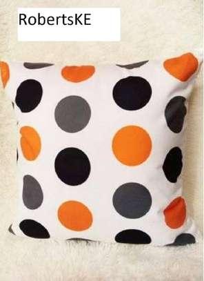 orange and black polka dots pillow image 1