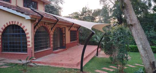 Designs and installation of shades sails canopies car shades etc image 1