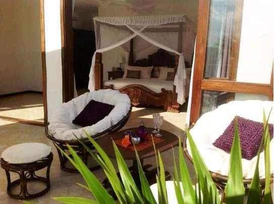 3 bedroom fully furnished own compound image 6