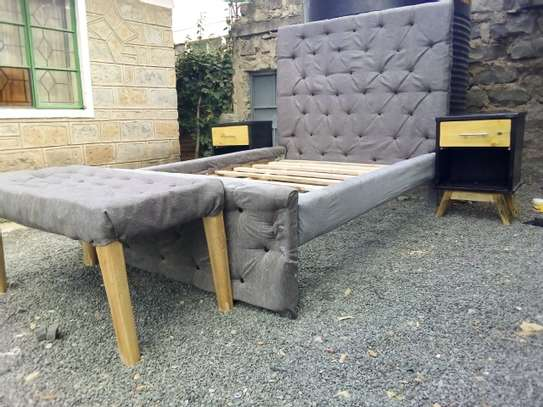 A Tufted 4 by 6 Hardwood bed