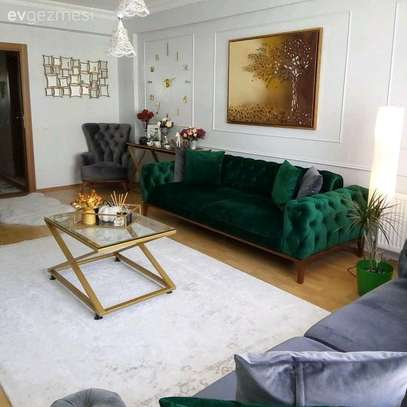 Three seater Chesterfield sofas/green sofas image 1