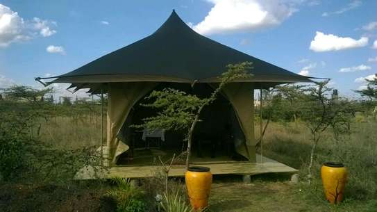 Glamping tented camping cottages, canvas works, awnings & canopies.