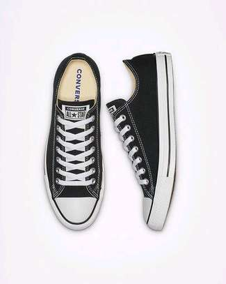 Black and white low cut converse sneakers image 1