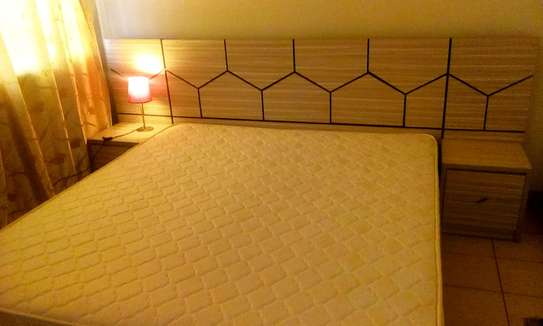 King size bed, 2 side tables and high density matresses