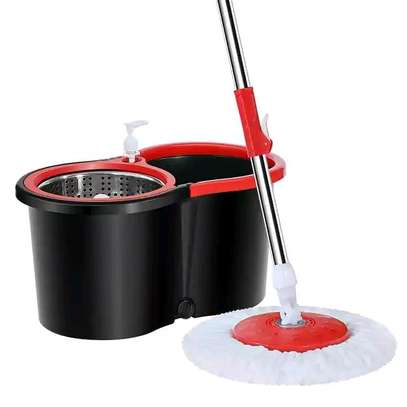 Spin mop with metalic spinner, attached soap dispenser and wheels