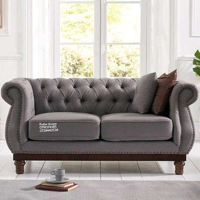 Modern grey two seater Chesterfield sofa image 1