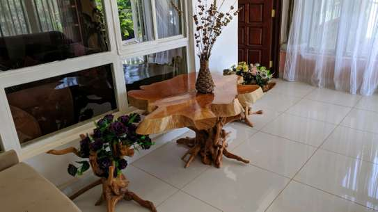 Wooden polished Coffee Table (Cyprus top & tea bush frame support)
