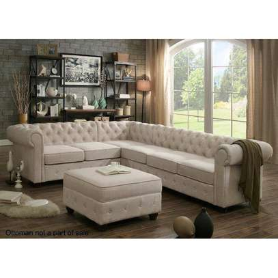 Beige chesterfield sofas for sale in Nairobi Kenya/six seater L sofas for sale in Nairobi Kenya/pouf image 1