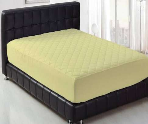 mattress protector yellow 5  by 6
