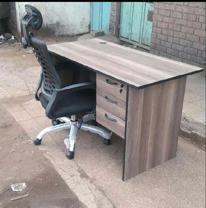 An office table with black compatible headrest chair image 1