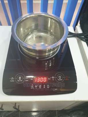 Fast Efficient and Easy to Use Induction Cooker image 1