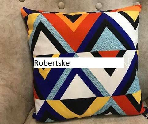 Printed Throw Pillow with a pinch of blue, orange and white image 1