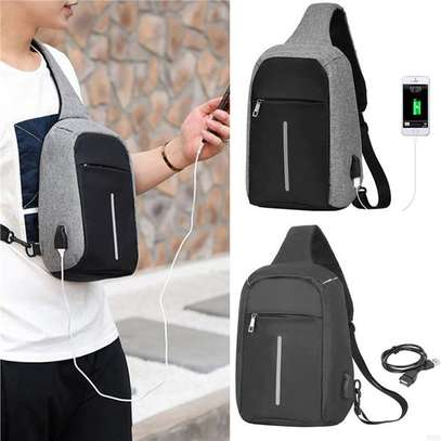 CROSSBODY ANTI THEFT BAG WITH A USB CABLE