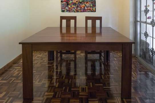 Solid red mahogany dining table