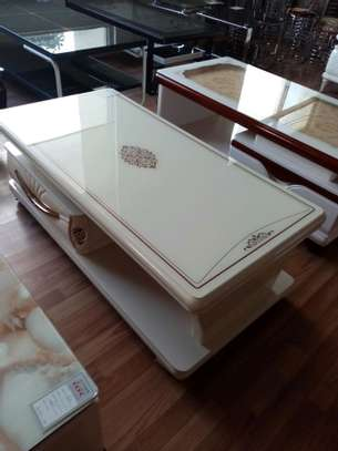 Glass top coffee table image 1
