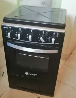 Nunix K50-Y01 -3Gas, 1Hot Plate, Rotisserie, Auto Ignition 50*55cm Free Standing Cooker image 1