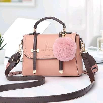 Beige fancy handbags image 1