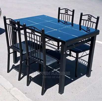 The dining table with 4 cozy metallic sponged seats image 1
