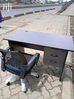 An office desk with a black five star office chair image 1