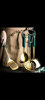 Golden serving spoons image 1