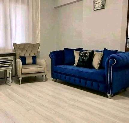 A 3 seater sofa and a king chair image 1