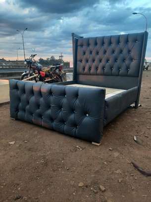 A dark gray Chesterfield image 1
