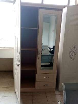 Bedroom clothes storage closet image 1