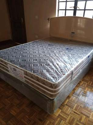 5 by 6 Spring Mattress plus Bed. Free Delivery. image 2