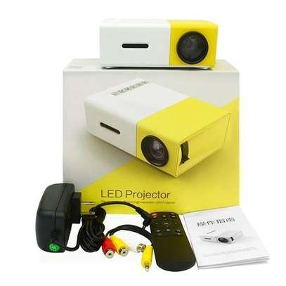 LED Mini Home Projector  - yellow & white image 1