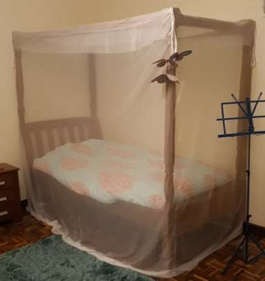 Single bed with mattress, beddings and mosquito net