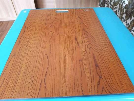 Laminated wooden floor tiles image 1