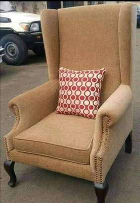Plain brown wing chair image 1