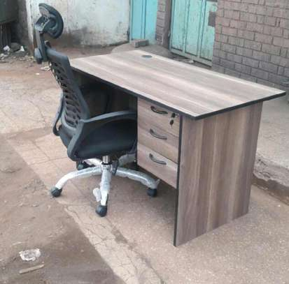 High back adjustable office chair plus an office table image 1
