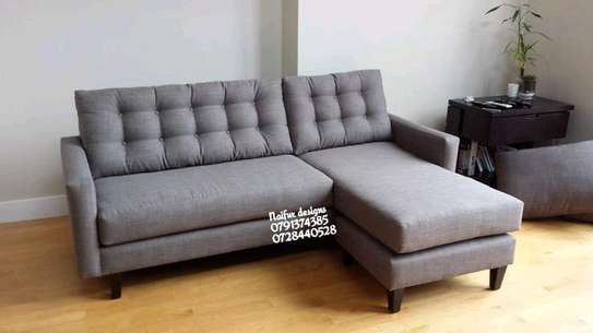 Grey four seater L shaped sofa image 1