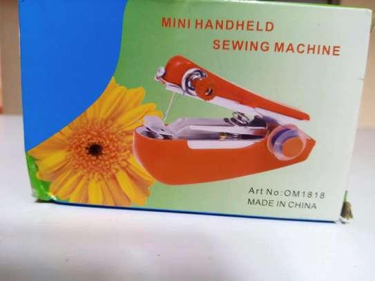 Mini handheld sewing machine image 1