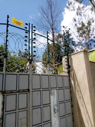 Electric fence installation in Kenya image 1