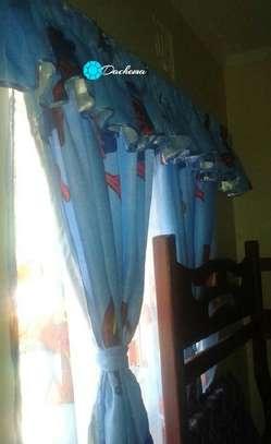 blue cartoon themed curtains image 1