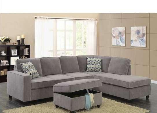 L-shaped light grey back pillowed sofa image 1