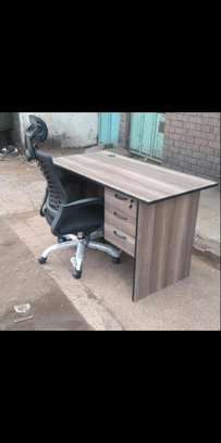 An office table with a comfortable black adjustable office chair image 1