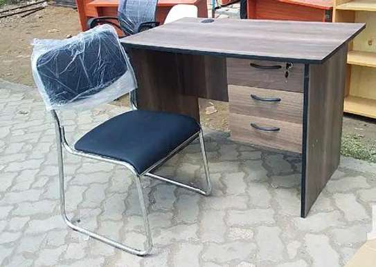 Walnut color office table with a black padded office seat image 1