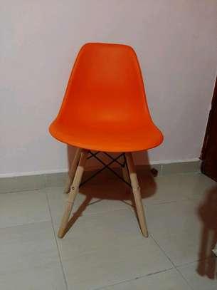 Orange eames chair image 1