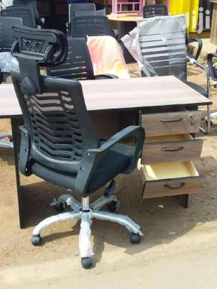 Adjustable office chair with a sleek modern look and an office desk image 1