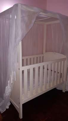 Baby crib and changing unit