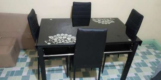 Dining table with mettalic frame plus 4 seats image 1