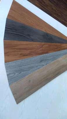 Pvc vinyl floor Tiles That uses glue image 3
