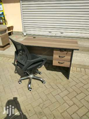 An adjustable office chair with premium quality plus an office table image 1