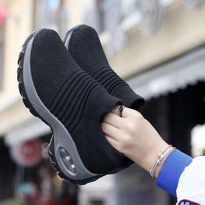 Flyknit sneakers image 1