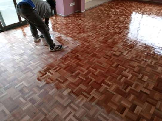 Wooden floor installation sanding and polishing services. image 5